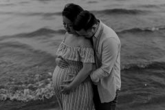 Couple by the water. Maternity Photoshoot